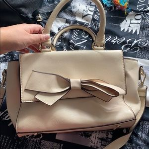 Tan purse with bow